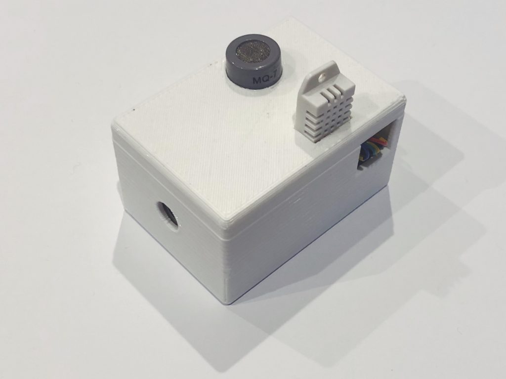 Arduino Bluetooth air quality sensors. The hole at the front lets in the air to the dust particle sensor, the grey round sensor is the MQ-7 carbon monoxide sensor, and the white rectangular sensor reads the temperature/humidity.